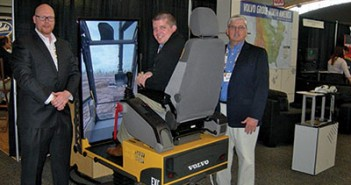Equipping the shale: Volvo's Jack Bolton and John Duff show Brad Burris (center) of Rudd Equipment Co. the company's wares at Marcellus-Utica Midstream.