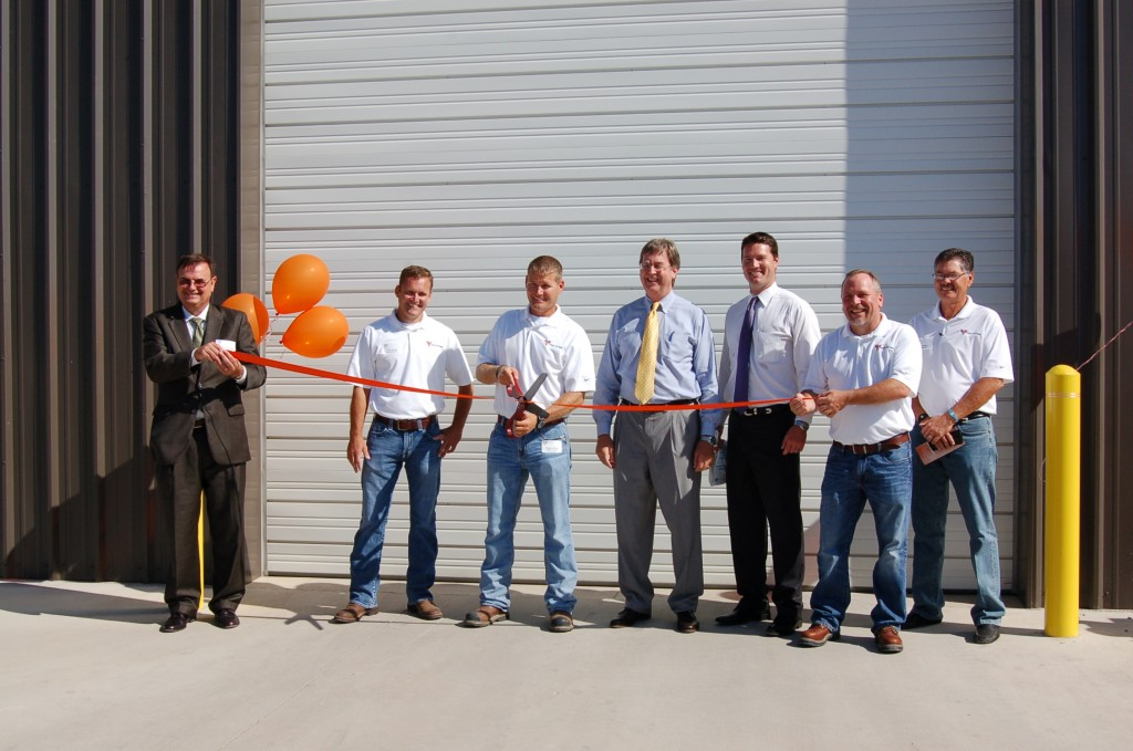 From left, Brien Thorstenberg, vice president of economic development Tulsa Regional Chamber, Troy Young, vice president Tulsa Rig Iron, Trevor Young, president Tulsa Rig Iron, Tulsa Mayor Dewey Bartlett, Jerred Brejcha, mayor's chief of staff, Terry Flynn, business development for Tulsa Rig Iron and Mike Sadler, national sales manager for Tulsa Rig Iron cut the ceremonial ribbon the newly expanded production facility.