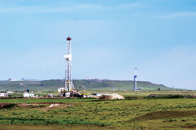 As oil prices have plunged, oil and gas exploration companies are taking more drilling rigs out of service. Lower crude and natural gas prices will eventually hammer the midstream industry when those companies slash production.