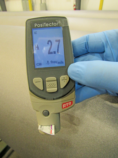 Electronic data is determining and stored into forms automatically. In this image, a new gauge is used to read the surface profile of a blast-cleaned surface using Testex tape, replacing micrometer readings and manual entry on forms.