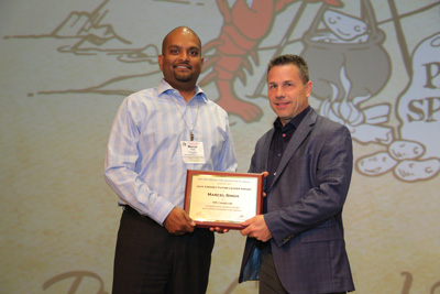 PLCAC 2016 Jack Cressey Future Leader Award recipient Marcel Singh with PLCAC immediate past president, Mark H. Scherer.