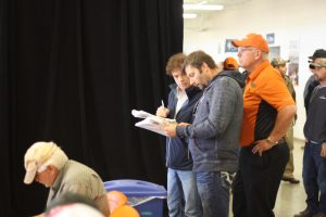 Waschuk Pipeline VP Kevin Waschuk (far left) bids on some pipelayers at the Ritchie Bros. auction in Columbus, Ohio.