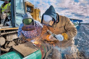 welders on Harpster-Lima pipeline