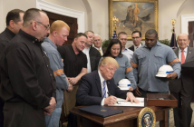 Trump signs steel, aluminum tariffs
