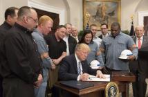 Trump signs steel, aluminum tariffs