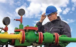 worker at pipeline valves