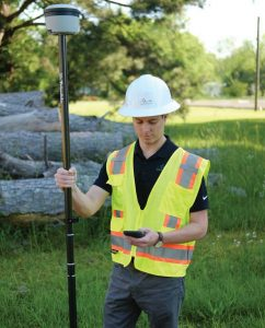 Worker with Trimble equipment