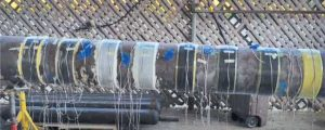 A test pipe is wrapped with multiple composite systems