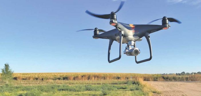 drone flying over a field