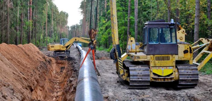 pipelayer and excavator