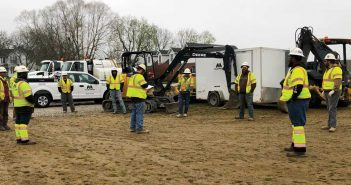 Miller Pipeline crews in their daily morning huddle following social distancing practices